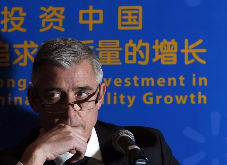 Chief Executive Officer of Wal-Mart China Greg Foran attends a news conference in Beijing, October 24, 2013.  REUTERS/Kim Kyung-Hoon