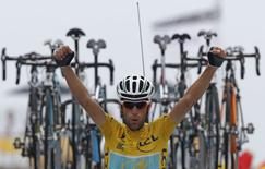 Race leader Astana team rider Vincenzo Nibali of Italy celebrates as he crosses the finish line to win the 145.5km 18th stage of the Tour de France cycling race between Pau and Hautacam, July 24, 2014.   REUTERS/Jean-Paul Pelissier
