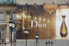 A huge advertisement for Dior perfume installed on the facade of a building is seen at the Place Vendome in Paris March 18, 2014. REUTERS/Charles Platiau