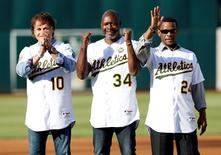 Former Oakland Athletics manager Tony La Russa (10), and players Dave Stewart (34) and Rickey Henderson (24) during the 1989 Oakland Athletics World Series team tribute before the game against the Baltimore Orioles at O.co Coliseum. Jul 19, 2014; Oakland, CA, USA; Bob Stanton-USA TODAY Sports