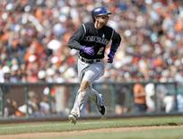 Jun 15, 2014; San Francisco, CA, USA; Colorado Rockies shortstop Troy Tulowitzki (2) heads home on a Rockies first baseman Justin Morneau (not pictured) double during the eighth inning against the San Francisco Giants at AT&T Park. Mandatory Credit: Bob Stanton-USA TODAY Sports