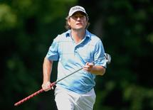 Jul 26, 2014; Ile Bizard, Quebec, CAN; Tim Clark tees off the 12th hole during the third round of the RBC Canadian Open at Royal Montreal GC - Blue Course. Mandatory Credit: Eric Bolte-USA TODAY Sports