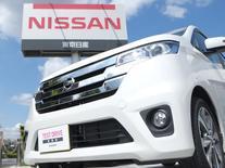Nissan Motor a annoncé lundi une hausse de 13,4% de son bénéfice d'exploitation sur la période avril-juin, grâce à une amélioration des vente aux Etats-Unis consécutive à des changements intervenus dans les opérations de supervision. /Photo prise le 28 juillet 2014/REUTERS/Toru Hanai