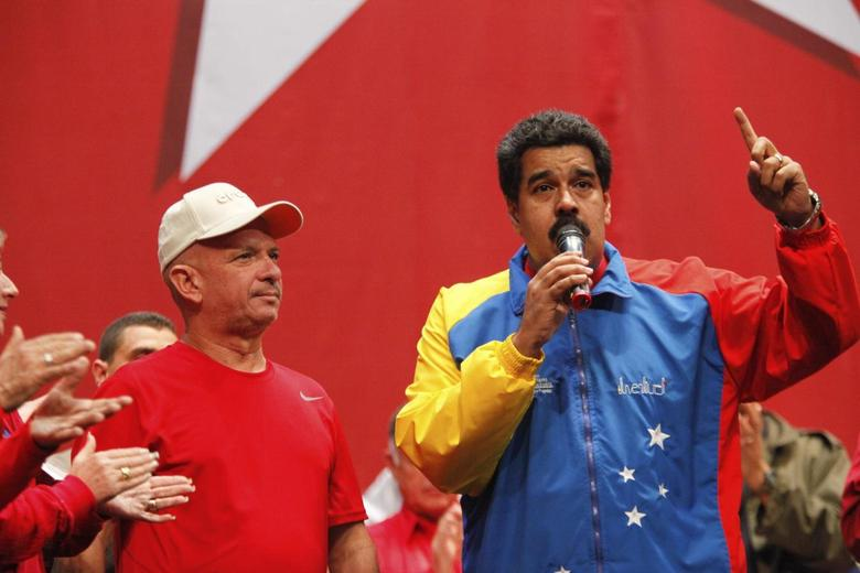 Venezuela's President Nicolas Maduro (R) speaks next to retired General Hugo Carvajal as they attends the Socialist party congress in Caracas July 27, 2014. REUTERS/Miraflores Palace/Handout via Reuters