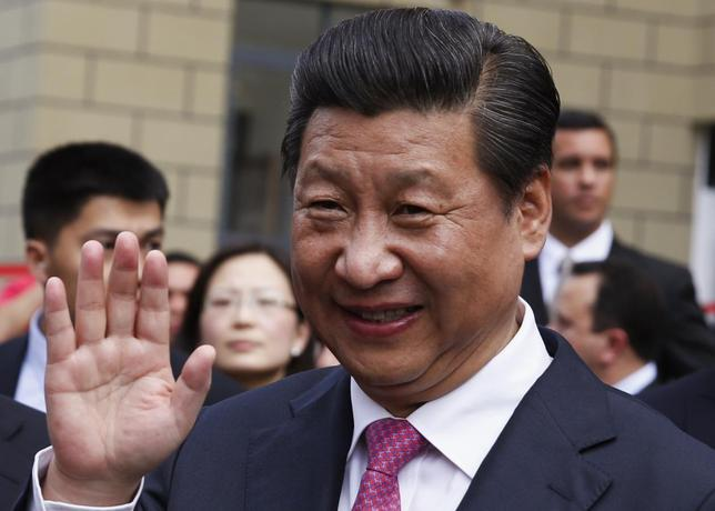 China's President Xi Jinping waves during a visit to a housing development in Caracas July 21, 2014. REUTERS/Carlos Garcia Rawlins