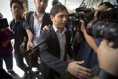 Le ministre argentin de l'Economie Axel Kicillof à New York. L'Argentine était engagée mercredi dans une course contre la montre pour éviter un second défaut de paiement en douze ans en parvenant à un accord d'ici la fin de la journée avec certains de ses créanciers ou en obtenant un sursis de la justice américaine. /Photo prise le 30 juillet 2014/REUTERS/Carlo Allegri
