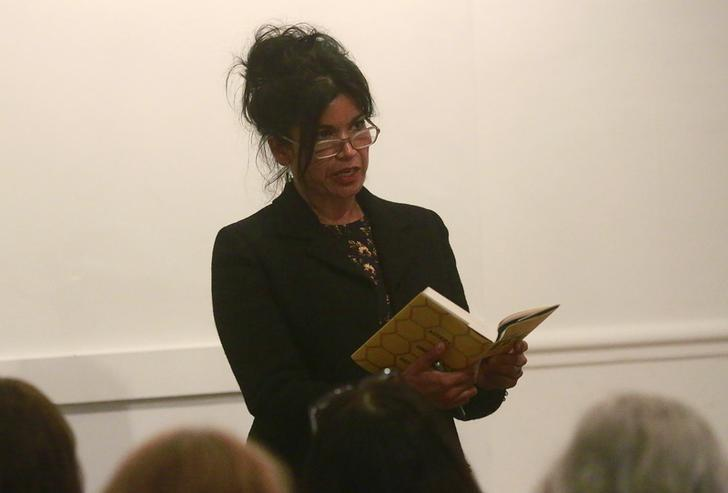 Laline Paull reads from her book ''The Bees'' during a meeting of Vanguard Readings in London May 20, 2014.   REUTERS/Russell Boyce