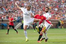 Aug 2, 2014; Ann Arbor, MI, USA; Manchester United forward Wayne Rooney (10) battles for the ball against Real Madrid defender Pepe (3) and defender Alvaro Arbeloa (17) during the second half at Michigan Stadium. Tim Fuller-USA TODAY Sports