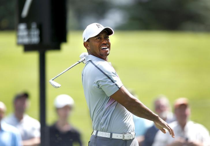 Jul 31, 2014; Akron, OH, USA; Tiger Woods reacts to his tee shot on the seventh hole during the first round of the WGC-Bridgestone Invitational golf tournament at Firestone Country Club - South Course.  Joe Maiorana-USA TODAY Sports