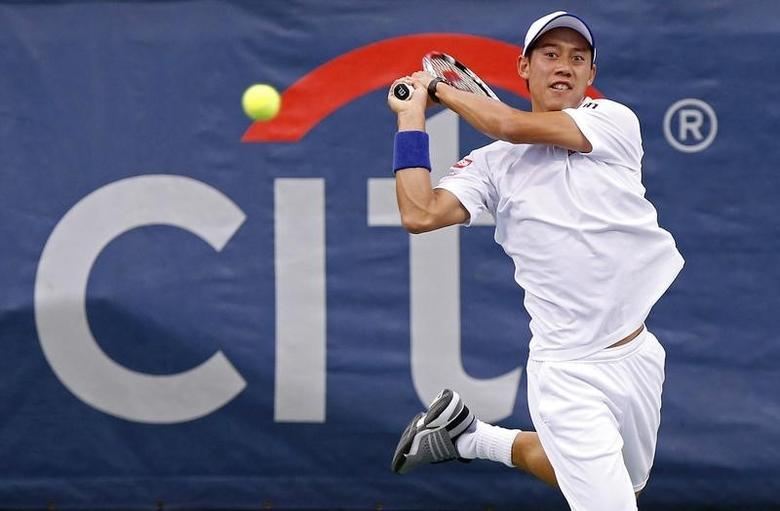 Kei Nishikori hits a backhand against Richard Gasquet (not pictured) on day five of the Citi Open tennis tournament at the Fitzgerald Tennis Center. Gasquet won 6-1, 6-4 on August 1, 2014.   USA TODAY Sports/Geoff Burke