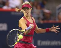 Aug 5, 2014; Montreal, Quebec, Canada; Eugenie Bouchard of Canada plays against Shelby Rogers of Unites States on day two of the Rogers Cup tennis tournament at Uniprix Stadium. Mandatory Credit: Jean-Yves Ahern-USA TODAY Sports - RTR41DHN