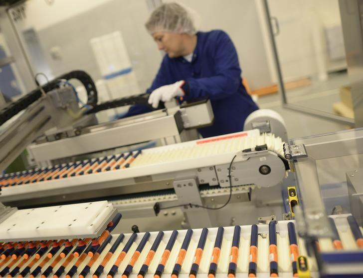 A Novo Nordisk employee controls a machine at an insulin production line in a plant in Kalundborg November 4, 2013.  REUTERS/Fabian Bimmer