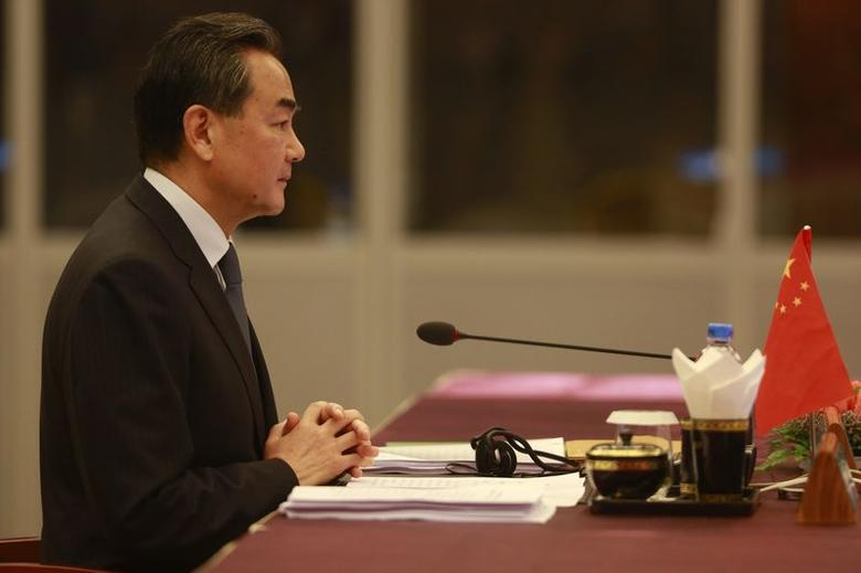 Chinese Foreign Minister Wang Yi attends the ASEAN-CHINA Ministerial Meeting at the Myanmar International Convention Centre (MICC) in Naypyitaw, August 9, 2014. REUTERS/Soe Zeya Tun/Files