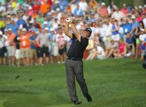 Phil Mickelson of the U.S. hits his second shot on the 12th hole during the final round of the 2014 PGA Championship at Valhalla Golf Club in Louisville, Kentucky, August 10, 2014. REUTERS/Brian Snyder