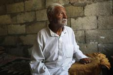 Ibrahim Mohammad al-Toum, 85, poses in his home that he says has been bombed three times in six years by the Israeli army, in Gaza City, August 11, 2014.  REUTERS/Siegfried Modola