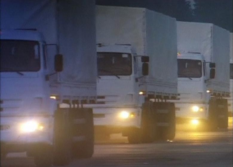 A Russian convoy of trucks carrying humanitarian aid for Ukraine sets off from near Moscow in this still image taken from video August 12, 2014. REUTERS/Reuters TV