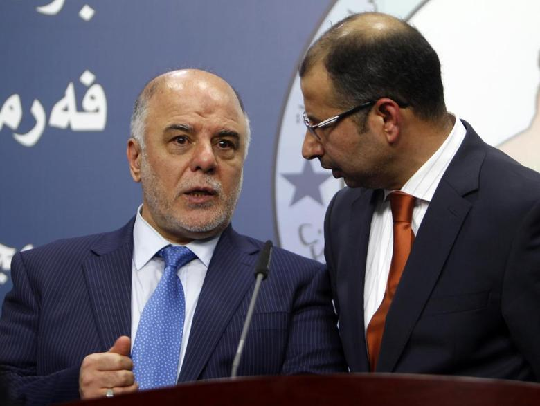 Salim al-Jabouri (R), speaker of the Iraqi Council of Representatives, and Haider Abadi (L), a member of Iraqi Prime Minister Nuri al-Maliki's State of Law bloc, speak during a news conference in Baghdad, July 15, 2014.   REUTERS/Ahmed Saad