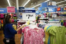 An employee cleans a clothes rack at the Walmart Supercenter in Bentonville, Arkansas June 5, 2014.  The Walmart Stores Inc. annual shareholder meeting takes place June 6, 2014. REUTERS/Rick Wilking