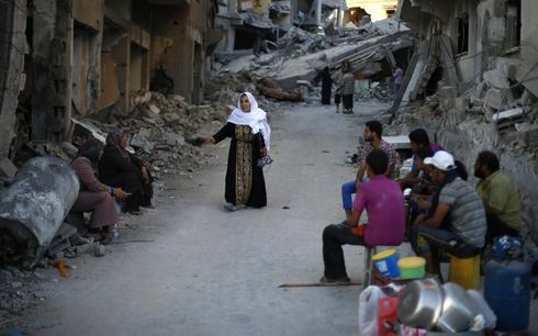 Gaza town Beit Hanoun sweeps rubble, tries to return to daily life