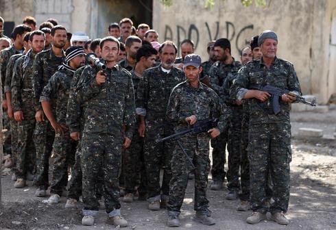 Yazidis take up arms