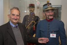 Jean Dauphin (L), aged 90, poses with man who is dressed as a WW1 French soldier, August 13, 2014, in the museum he created in the Belgium village of Latour and which is dedicated to the area's WW1 history.   REUTERS/Philippe Wojazer