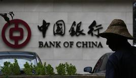 """La sede del Banco de China en Pekín, jul 14 2014. China aliviará aún más la política monetaria a través de reducciones """"modestas"""" de las tasas de interés y encajes bancarios el próximo año para alentar el crecimiento económico, dijo un investigador de un centro de estudios del Gobierno.  REUTERS/Kim Kyung-Hoon"""
