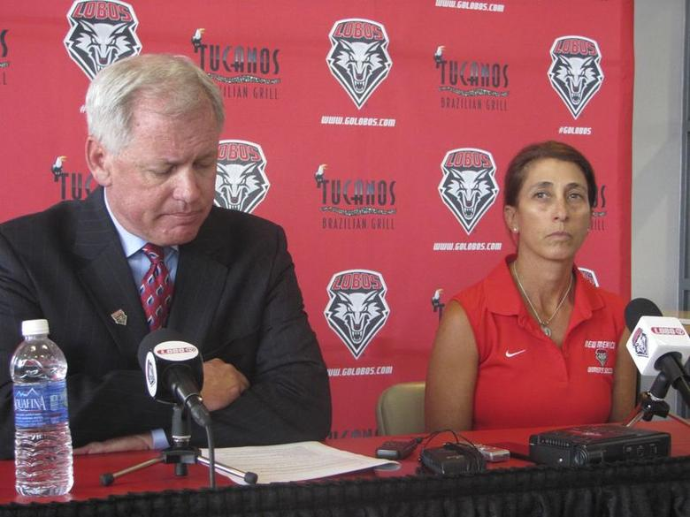 University of New Mexico (UNM) vice president of athletics Paul Krebs (L) and Women's head soccer coach Kit Vela speak to reporters during a news conference in Albuquerque August 20, 2014.     REUTERS/Joe Kolb