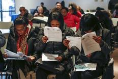 People fill out application forms before a screening session for seasonal jobs at Coney Island in the Brooklyn borough of New York March 4, 2014. REUTERS/Shannon Stapleton