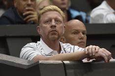 Boris Becker, the coach of Novak Djokovic of Serbia, sits on Centere Court for the men's singles tennis match between Djokovic and Jo-Wilfried Tsonga of France at the Wimbledon Tennis Championships, in London June 30, 2014. REUTERS/Toby Melville/Files