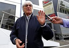 Formula One Chief Executive Bernie Ecclestone talks to reporters before the weekend's Belgian F1 Grand Prix in Spa-Francorchamps August 22, 2014. REUTERS/Yves Herman