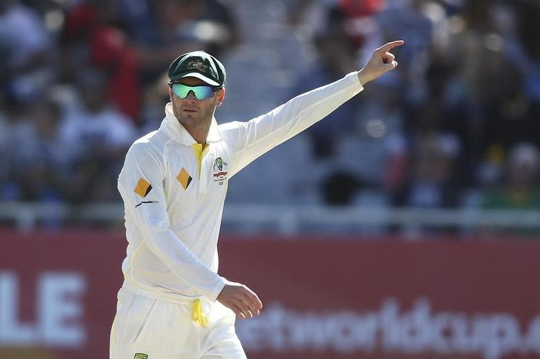 Australia's Michael Clarke sets the field during the third day of the third cricket test match against South Africa at Newlands Stadium in Cape Town, March 3, 2014. REUTERS/Shaun Roy