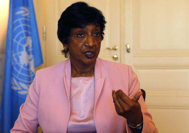 Outgoing U.N. Human Rights Commissioner Navi Pillay talks during an interview to Reuters in her office in Geneva August 19, 2014.  REUTERS/Ruben Sprich