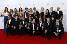 """The cast and crew of AMC's """"Breaking Bad"""" pose with their outstanding drama series award at the 66th Primetime Emmy Awards in Los Angeles, California August 25, 2014.  REUTERS/Mike Blake"""