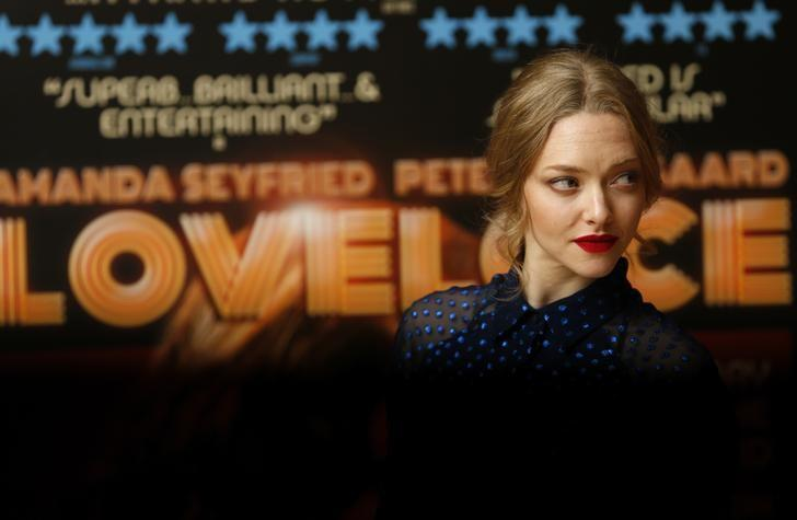 Actress Amanda Seyfried poses for photographers before a screening of her  new film Lovelace at a hotel in Mayfair, London August 12, 2013.