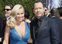Actress Jenny McCarthy (L) and actor Donnie Wahlberg (R) pose at the 2014 Creative Arts Emmy Awards in Los Angeles, California August 16, 2014.  REUTERS/Danny Moloshok