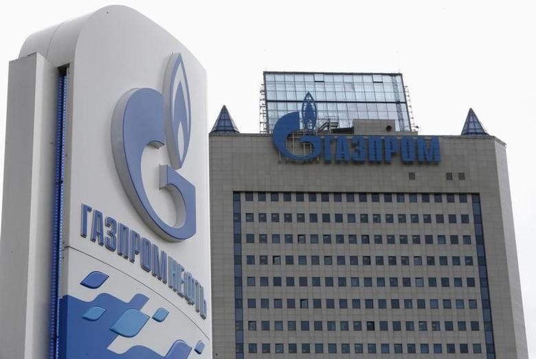 A general view shows the headquarters of Gazprom, with a board of Gazprom Neft, the oil arm of Gazprom seen in the foreground, on the day of the annual general meeting of the company's shareholders in Moscow, June 27, 2014. REUTERS/Sergei Karpukhin