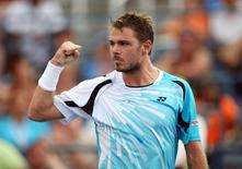 Sep 1, 2014; New York, NY, USA; Stanislas Wawrinka (SUI) reacts after winning the first set of his match against Tommy Robredo (ESP) on day eight of the 2014 U.S. Open tennis tournament at USTA Billie Jean King National Tennis Center. Jerry Lai-USA TODAY Sports