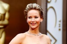 """Jennifer Lawrence, best supporting actress nominee for her role in """"American Hustle,"""" arrives at the 86th Academy Awards in Hollywood, California March 2, 2014.    REUTERS/Lucas Jackson"""