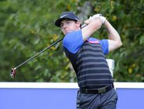 Sep 1, 2014; Norton, MA, USA; Rory McIlroy hits his tee shot on the 4th hole during the final round of the Deutsche Bank Championship golf tournament at TPC of Boston. Mandatory Credit: Mark Konezny-USA TODAY Sports