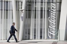 A man walks past a Telefonica building in Barcelona, July 31, 2014.   REUTERS/Albert Gea