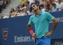 Roger Federer of Switzerland reacts after a missed point against Marin Cilic of Croatia during their semi-final match at the 2014 U.S. Open tennis tournament in New York, September 6, 2014.      REUTERS/Mike Segar