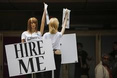 "Motorized mannequins hold signs that read ""Hire Me"" in Toronto May 23, 2014.  REUTERS/Mark Blinch"