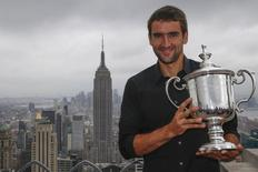 Marin Cilic of Croatia holds his U.S. Open tennis tournament trophy at the Top of the Rock Observation Deck at Rockefeller Center during a media photo opportunity in New York, September 9, 2014.  REUTERS/Shannon Stapleton
