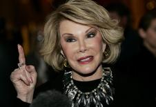 Comedian Joan Rivers talks to reporters as she arrives for a gala honoring the late stand-up comedian George Carlin, the 11th Annual Mark Twain Prize for American Humor recipient, at the Kennedy Center in Washington, in this November 10, 2008 file photo. REUTERS/Molly Riley/Files