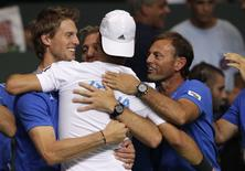 Italy's Fabio Fognini reacts with team members after winning their Davis Cup semi-final double tennis match against Switzerland at the Palexpo in Geneva September 13, 2014.  REUTERS/Denis Balibouse