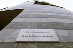 A sign is seen beside the entrance of the Bank for International Settlements (BIS) in Basel December 5, 2013. REUTERS/Arnd Wiegmann