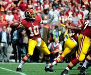Washington Redskins quarterback Robert Griffin (10) attempts a pass against the Jacksonville Jaguars during the first half at FedEx Field. Mandatory Credit: Brad Mills-USA TODAY Sports
