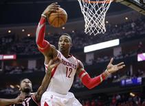 Apr 30, 2014; Houston, TX, USA; Houston Rockets center Dwight Howard (12) gets a rebound during the second quarter against the Portland Trail Blazers in game five of the first round of the 2014 NBA Playoffs at Toyota Center. Mandatory Credit: Troy Taormina-USA TODAY Sports