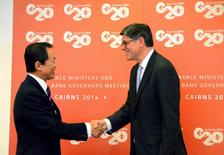 Japan's Finance Minister Taro Aso (L) and U.S. Treasury Secretary Jack Lew shake hands before the start of their bilateral meeting ahead of the G20 Finance Ministers and Central Bank Governors meeting in the northern Australian city of Cairns September 19, 2014.   REUTERS/Lincoln Feast