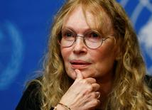 U.S. actress Mia Farrow speaks during a news conference in Geneva in this November 14, 2013 file photo.   REUTERS/Denis Balibouse/Files